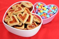 Heart shape cookies. And love candies in bowl stock images