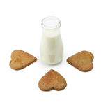 Heart shape cookies poiting at a bootle of milk Stock Photos