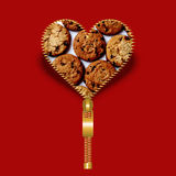 Heart shape with cookies texture within. Heart with shadow behind, created from golden fastener and expressing the love for cookies, on dark red background stock images