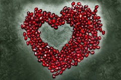 Heart shape copy space from pomegranate seed's stock photo