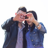Heart shape from couple hands Stock Photos