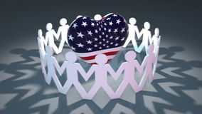 Heart shape covered in stars and stripes. Video of a circle of little characters holding hands and dancing around a large heart shaped object covered in the stock illustration
