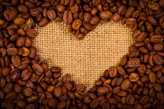 Heart shape created with coffee beans Royalty Free Stock Photography