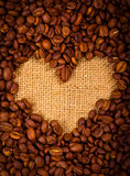 Heart shape created with coffee beans Royalty Free Stock Photos
