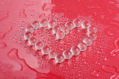 Heart shape from crystals. Heart shape collected from silicon bubbles Royalty Free Stock Photo