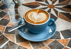 Heart shape on a cup of coffee royalty free stock photo