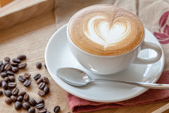 a cup of coffee with heart shaped latte art Stock Photos