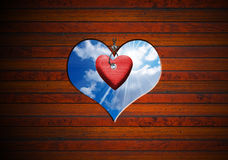 Heart Shape cut on Brown Wooden Wall Royalty Free Stock Images