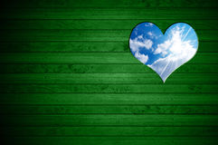 Heart Shape cut on Green Wooden Wall Royalty Free Stock Photo