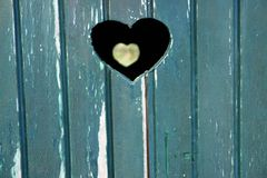 Heart shape cut into wooden door Stock Photography