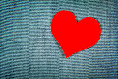 Heart Shape on Denim Background Stock Images