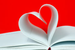 Heart shape of diary pages on a red Stock Photography