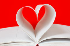 Heart shape of diary pages on a red Stock Photo