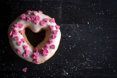 Sweet donuts with hearts. Heart shape donut on the dark background,selective focus and blank space Royalty Free Stock Photo
