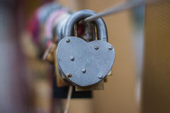 Heart shape door lock . Shallow depth of field, close up Stock Photos