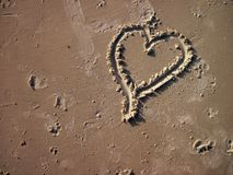 Heart shape drawing. Elevated view of heart shape drawing on the sand stock images