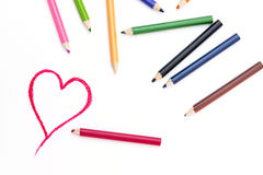 Heart Shape Drawing on White Paper. And some crayons in frame royalty free stock photos