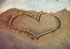 Heart shape drawn on the beach royalty free stock image