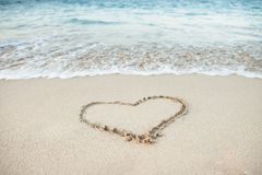 Heart Shape Drawn In Sand Royalty Free Stock Photos