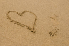 Heart shape drawn in the sand Stock Photography