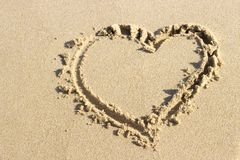 Heart shape drawn in sand, top view royalty free stock photo