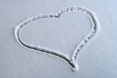 Heart shape drawn in the snow Stock Images