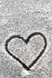 Heart shape drawn with the snow Royalty Free Stock Image