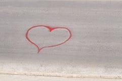 Heart shape drawn on a street asphalt Stock Photography
