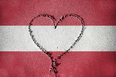 Heart shape drawning on sand with blending  Austria flag Stock Photography
