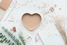Heart shape with dry branch flower and notepaper on white. Background.copy space Stock Image