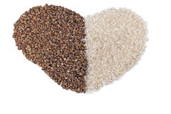 Heart shape dry buckwheet and rice isolated Stock Photos