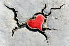 Heart shape in dry soil Stock Photo