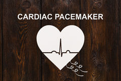 Heart shape with echocardiogram and CARDIAC PACEMAKER text. Cardiology concept Stock Image