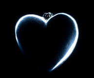 Heart shape emerging from a black background. Royalty Free Stock Photography