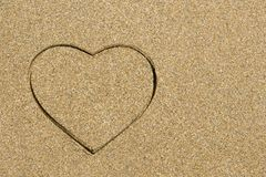 Heart shape engraved in a wet sandy beach Royalty Free Stock Photography