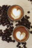 Heart Shape Espresso Coffee. With coffee beans Stock Image