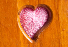 Heart shape fabric on wood Stock Images