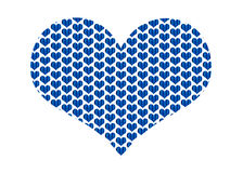 Heart shape filled with blue fabric hearts in a repeat pattern. A heart shape filled with hearts made of blue fabrics machine embroidered together. The hearts Royalty Free Stock Photos
