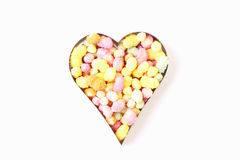 Heart shape filled with candy. Isolated on a white background Stock Images