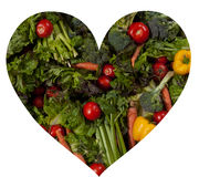 Heart shape filled with fresh vegetables Stock Images
