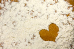 Heart shape in a flour Stock Images