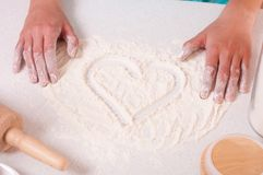 Heart shape on flour Royalty Free Stock Photo