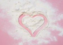 Heart shape on flour Stock Photo