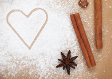 Heart shape on flour with spices Stock Images