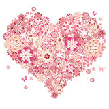 Heart shape with flowers and butterflies Royalty Free Stock Photo
