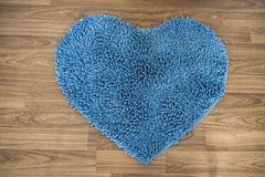 Heart shape, foot scraper carpet on wooden floor Stock Photography