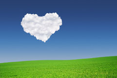 Heart shape formed from clouds in the blue sky Royalty Free Stock Photo
