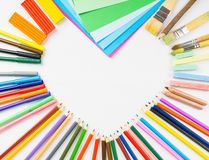 Heart shape frame from pencils, felt-tip pens and paper Royalty Free Stock Photography