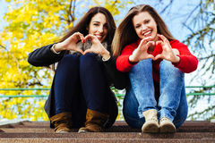 Heart shape from friends hands Stock Photography