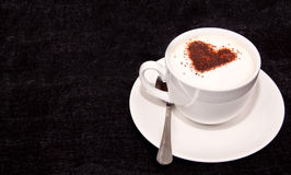 Heart shape on frothed coffee Stock Image